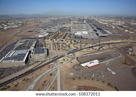 Aerial view of a very busy international airport - stock photo