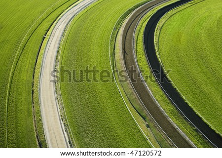 Aerial view of agricultural cropland fields. Horizontal shot. - stock photo