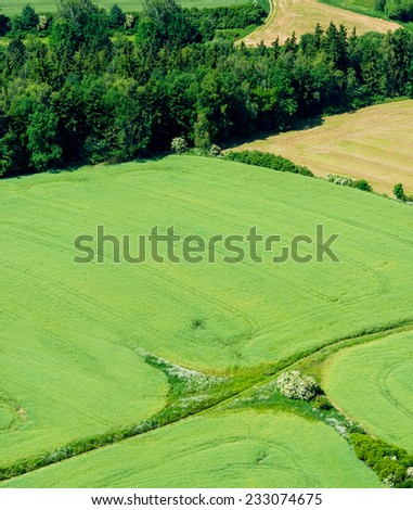 aerial view of agriculture fields with forest - stock photo
