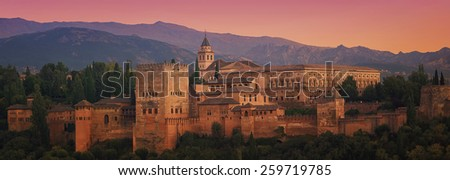 Aerial view of Alhambra Palace in Granada, Andalusia at sunset. Moorish fortress - famous landmark and major touristic attraction in Spain - stock photo