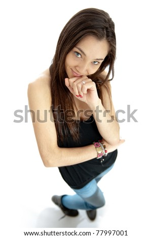 Aerial view of an attractive young brunette with a na?ve expression - stock photo