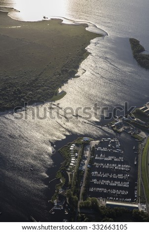 aerial view of an harbour, with marina, car park, ferry boat terminal a dike, Friesland, the Netherlands - stock photo