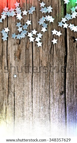 Aerial view of an old wooden table with christmas ornament and fresh snow - stock photo
