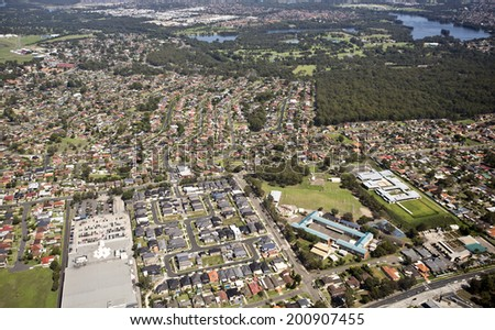 Aerial view of an urban area in Australia with residential and commercial properties - stock photo