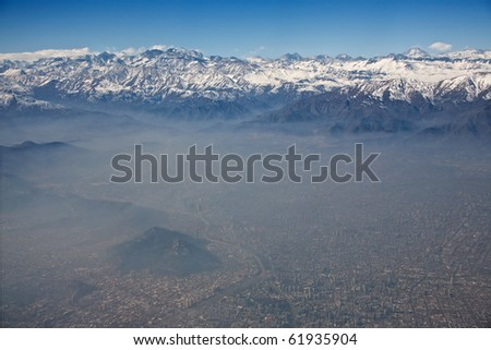 aerial view of Andes and Santiago with smog, Chile, focus on the mountains - stock photo