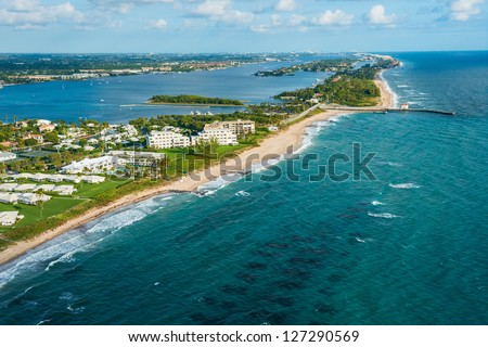 aerial view of atlantic ocean shoreline, intracoastal inlet and pier at boynton beach florida, with palm beach in the distance - stock photo