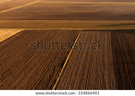 Aerial view of autumn agricultural field   - stock photo