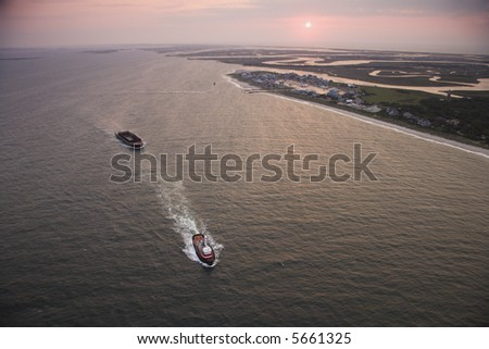 Aerial view of Bald Head Island North Carolina coastline during sunrise. - stock photo