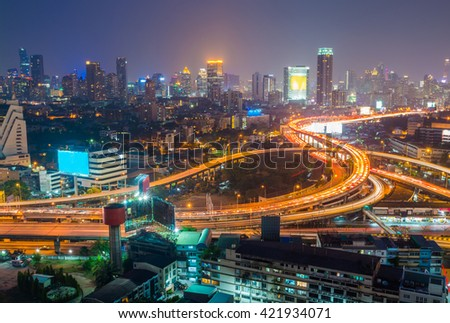 Aerial view of Bangkok city downtown background, highway interchanged at Night - stock photo