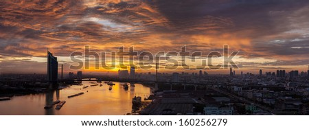 Aerial view of Bangkok Skyline along Chaophraya River sunset