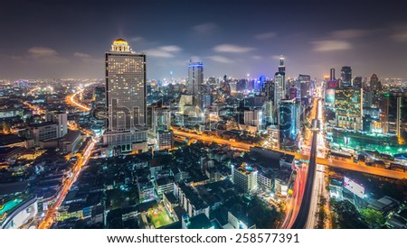 Aerial view of Bangkok skyline with urban skyscrapers at night - stock photo