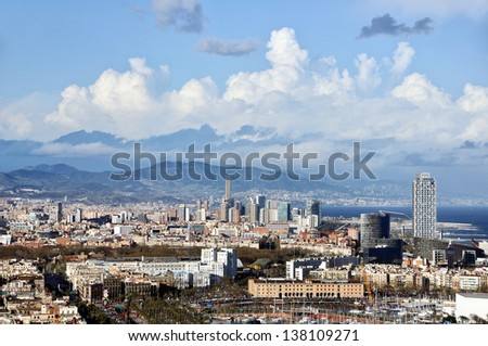 Aerial view of Barcelona, Spain with Clouds and Mountain