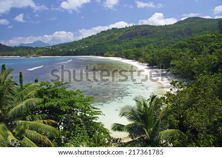 Aerial view of beach, Anse Takamaka, Mahe', Seychelles - stock photo