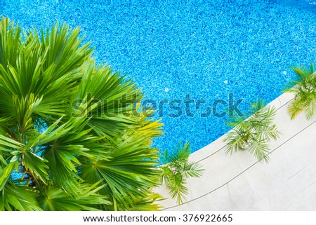 Aerial view of Beautiful luxury hotel swimming pool resort with umbrella and chair - Boost up color processing - stock photo
