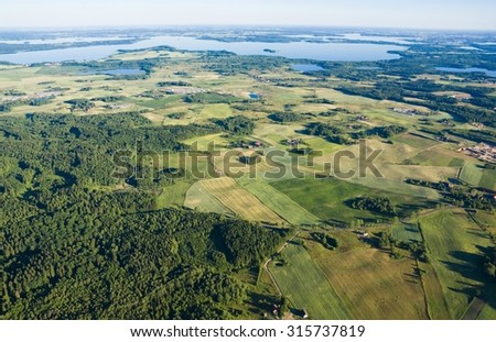 Aerial view of beautiful Masurian countryside, Poland - Kisajno and Dargin Lakes in the background