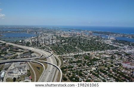 Aerial view of beautiful West Palm Beach, Florida, and the I-95 expressway - stock photo