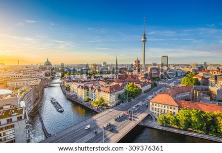 Aerial view of Berlin skyline with famous TV tower and Spree river in beautiful evening light at sunset, Germany - stock photo