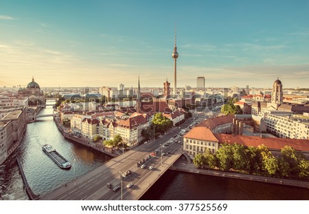 Aerial view of Berlin skyline with famous TV tower and Spree river in beautiful evening light at sunset with retro vintage Instagram style grunge pastel toned filter effect, Germany - stock photo