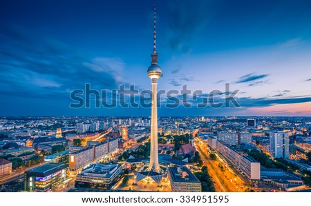 Aerial view of Berlin skyline with famous TV tower at Alexanderplatz and dramatic clouds in twilight during blue hour at dusk, Germany - stock photo