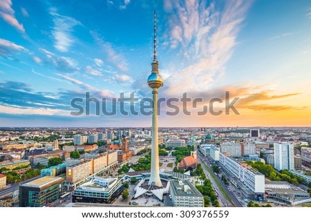 Aerial view of Berlin skyline with famous TV tower at Alexanderplatz and dramatic cloudscape at sunset, Germany - stock photo