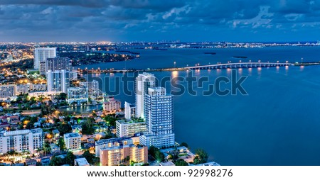 Aerial view of Biscayne Bay and Miami Beach at night. - stock photo