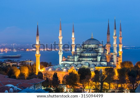 Aerial view of Blue Mosque in Istanbul at night. This is one of the most important islamic place where people go to pray. On background there are Bosphorus strait and Asian side of the city. - stock photo