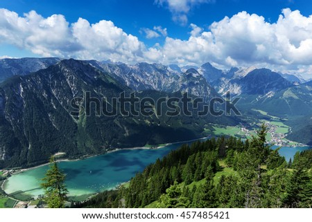 Aerial view of blue mountain lake between forested rocky mountains. Achensee, Austria, Tyrol - stock photo