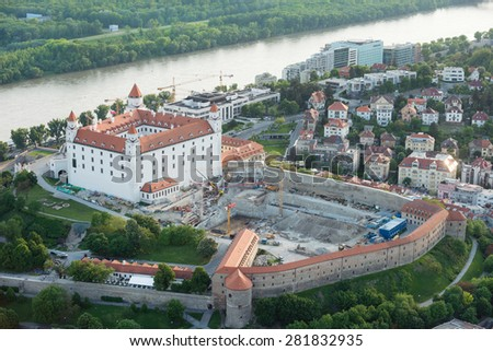 Aerial view of Bratislava castle and Danube river at dusk, Slovakia - stock photo