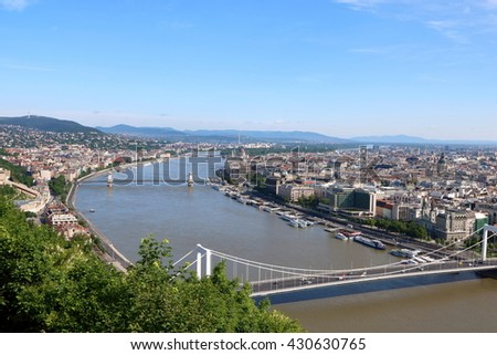Aerial view of Budapest with Hungarian Parliament Building, Chain Bridge, and Elizabeth Bridge in sight - stock photo