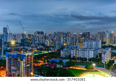 Aerial view of building construction site near the residential apartments skylines at Redhill neighborhood in Singapore at blue hour. Urban high rise construction and development concept - stock photo
