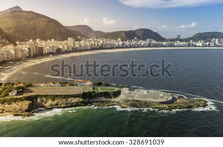 Aerial view of buildings on Copacabana Beach in Rio de Janeiro, Brazil - light leak - stock photo