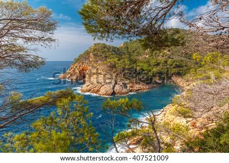 Aerial view of Cala Pola bay, coast of the Balearic Sea near Tossa de Mar, in the summer morning, Costa Brava, Catalunya, Spain - stock photo