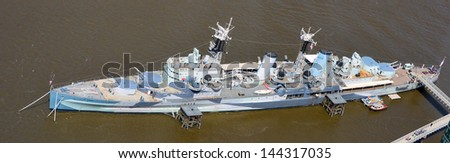 Aerial view of camouflage on warship HMS Belfast at permanent moorings on the River Thames in the Pool of London - stock photo