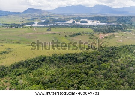 Aerial view of Canaima Lagoon waterfalls at river Carrao in Venezuela. Tepuis (table mountains) in the background - stock photo