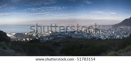 Aerial view of cape town and the bay from silent hill. In the center the waterfront and the city bowl, in the  right the table mountain and in the  left the soccer world cup stadium Green Point - stock photo