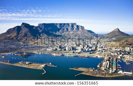 Aerial view of Cape Town city centre, with Table Mountain, Cape Town Harbour, Lion's Head and Devil's Peak - stock photo