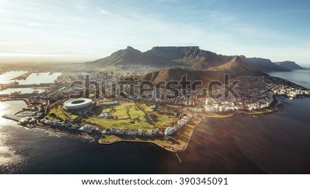 Aerial view of Cape Town with Cape Town Stadium, Lion's Head and Table mountain. - stock photo