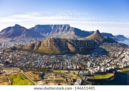 Aerial view of Cape Town, with Green Point and Sea Point, Table Mountain, Lion's Head, Signal Hill and Devil's Peak. - stock photo