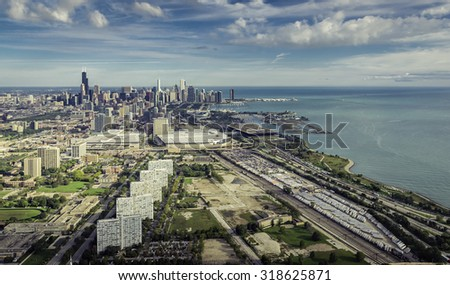 Aerial view of Chicago Downtown with railroad track and semi trailers warehouse - high angle - stock photo