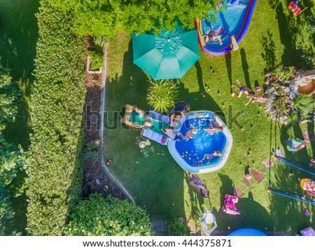Aerial view of children's party outdoor in summer. - stock photo
