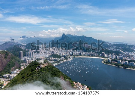 Aerial view of city and harbor of Rio de Janeiro in Brazil from cable car on Sugarloaf Mountain - stock photo