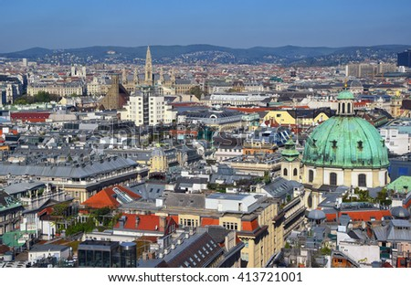 Aerial view of city center of Vienna with St.Peter church and town hall seen from St. Stephen's Cathedral in Austria - stock photo