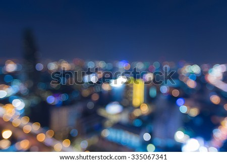 Aerial view of city downtown lights at night, abstract blurred bokeh background - stock photo
