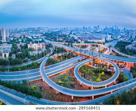 aerial view of city interchange in tianjin, panorama of highway junction - stock photo