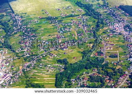 Aerial view of city suburb with many houses