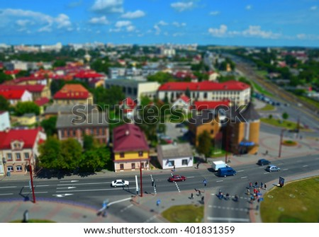 Aerial view of city with tilt shift effect in summer. Toy Town. Cityscape with traffic - stock photo