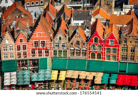Aerial view of colorful square and houses in Bruges, Belgium - stock photo