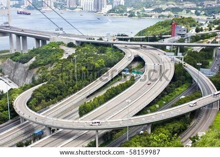 Aerial view of complex highway interchange in HongKong - stock photo