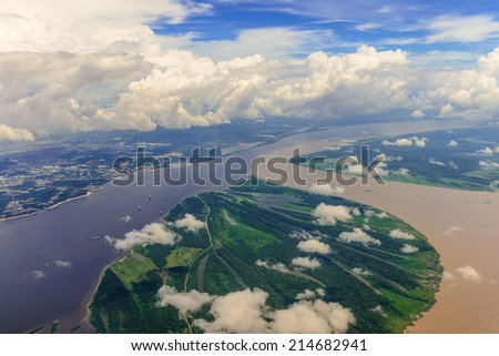 Aerial view of confluence of waters, forming Amazon river - stock photo