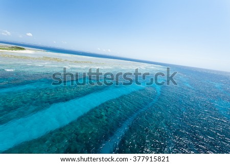 Aerial view of coral reef and clear tropical sea, Okinawa, Japan - stock photo